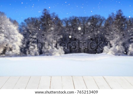 Winter season landscape with trees on the hills and snowy sky