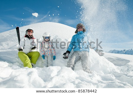 Winter, ski - family playing in snow - stock photo
