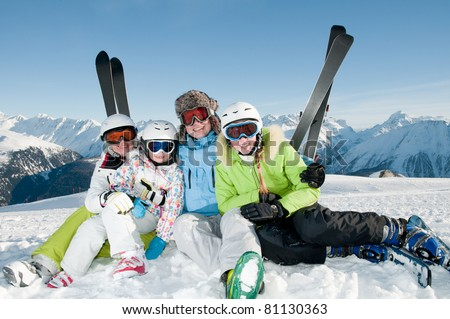 Winter, ski - happy family ski, sun and fun - stock photo
