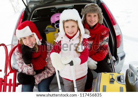 Winter, ski holidays, travel - family with baggage ready for the travel for winter holidays - stock photo