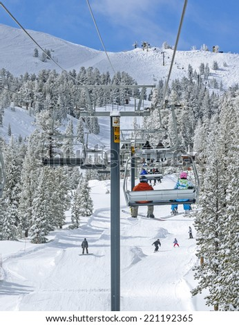 Winter ski lift riders