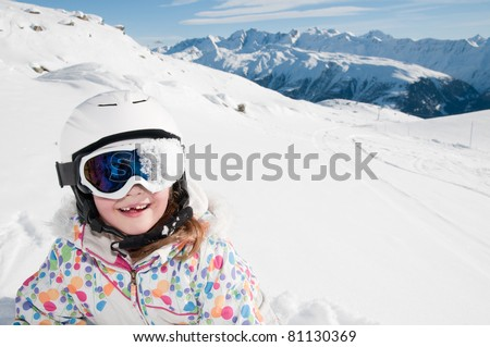 Winter, ski, snow and fun - little skier portrait - space for text - stock photo