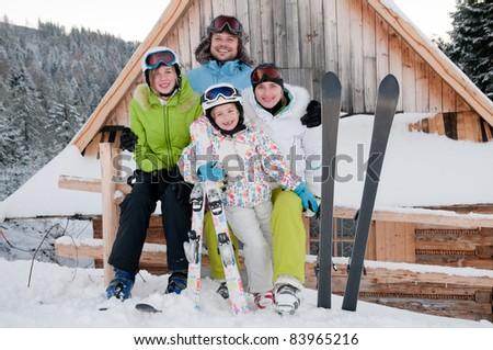 Winter, ski - Sporty family on winter vacation - stock photo