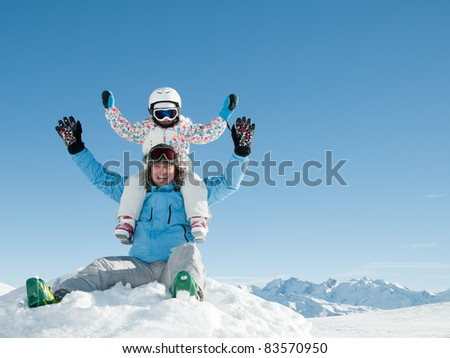 Winter, ski, sun and fun - happy family in winter resort (space for text) - stock photo