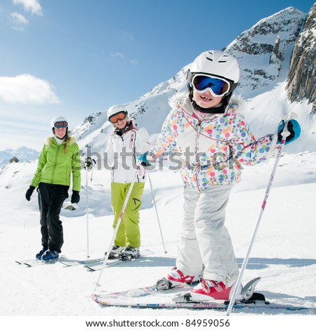 Winter, ski sun and fun - happy ski team - stock photo