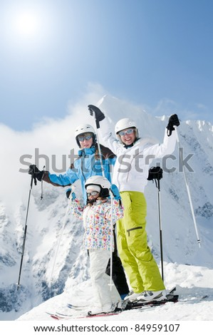 Winter, ski sun and fun - happy ski team (space for text, cover) - stock photo