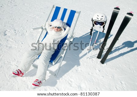 Winter, ski, sun and fun - happy skier in winter resort