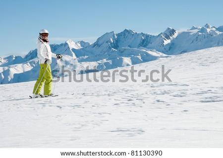 Winter, ski, sun and fun - happy skier in winter resort - stock photo