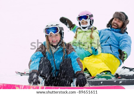 Winter, ski sun and fun - happy skiers playing in snow - stock photo