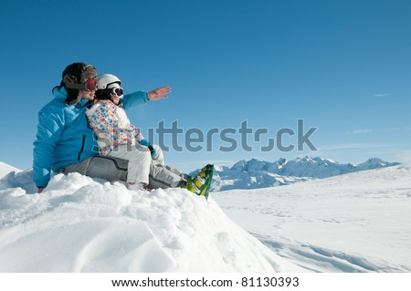 Winter, ski vacation - family in winter resort - stock photo
