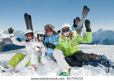 Winter, skiing - happy family in ski resort - stock photo