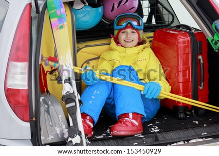 Winter, skiing, journey - girl with ski equipment ready for travel to ski resort - stock photo
