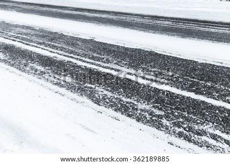 Winter slippery road background photo, asphalt pavement under fresh snow layer - stock photo