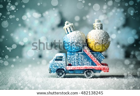 Winter, snow and car with toy. Car carrying a Christmas toy in a snow. Christmas background.