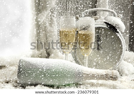 winter snow and champagne  - stock photo
