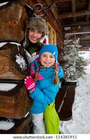 Winter, snow, apres ski - family fun at winter time - stock photo