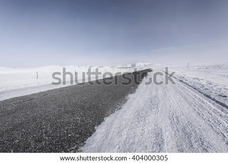 winter snow covered road - stock photo