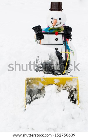 Winter, snow - happy snowman snow removal, winter fun - stock photo