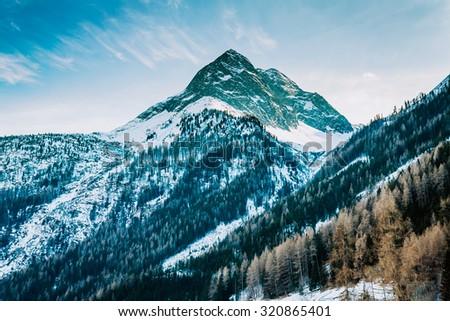 Winter snow mountain peaks Austrian alps - stock photo