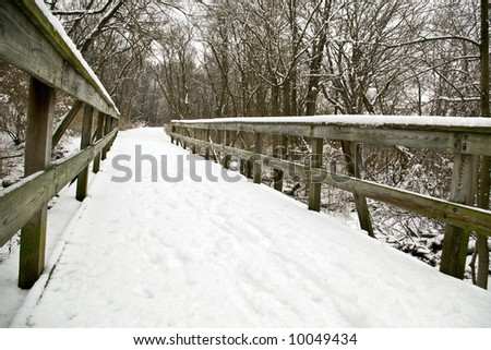 Winter snow scene of a fence and a snow covered path