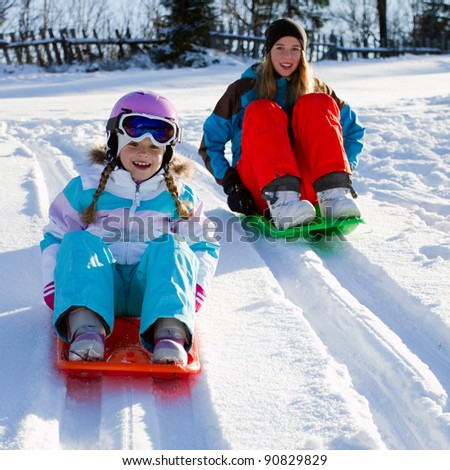 Winter, snow, sledding at winter time - stock photo