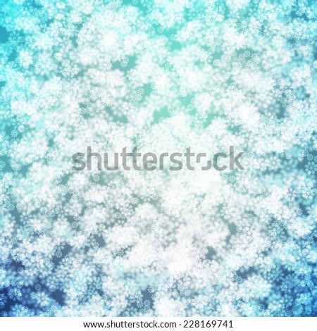 Winter Snow Sparkling Bokeh Light Effect Background with Blue and White Blurry Snowflakes - stock photo