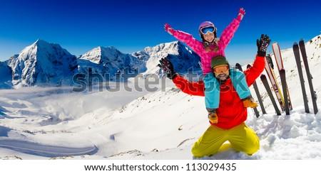Winter, snow, sun and fun - family enjoying winter vacations - stock photo