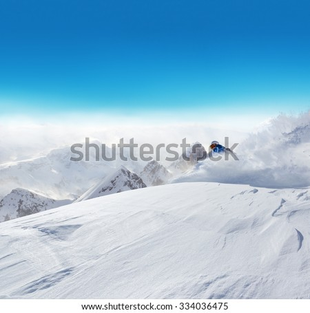 Winter snowy hill with meadow and blue sky