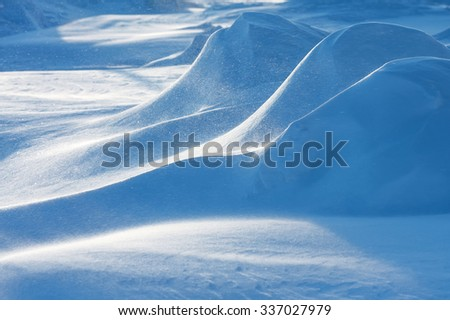 Winter snowy landscape with snowdrifts and snowstorm - stock photo