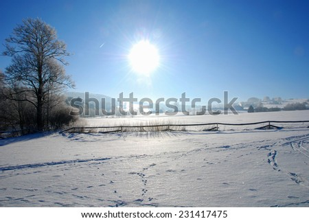 Winter snowy landscape with the sun - stock photo