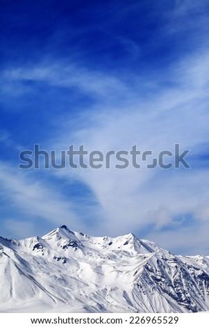 Winter snowy mountains at windy day. Caucasus Mountains, Georgia, Gudauri. View from ski resort. - stock photo