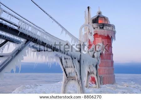 Winter, South Haven, Michigan Lighthouse glazed in ice, Lake Michigan, USA - stock photo