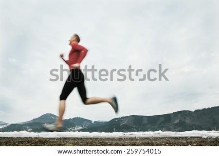 Winter speed runner - stock photo
