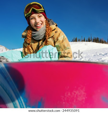 Winter sport, snowboarding - portrait of young snowboarder girl - stock photo