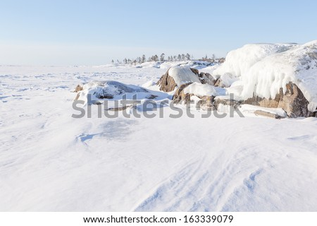 Winter, stony coast of the frozen lake.  winter landscape