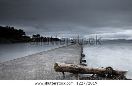 Winter-storm driftwood on a pier in Norway - stock photo