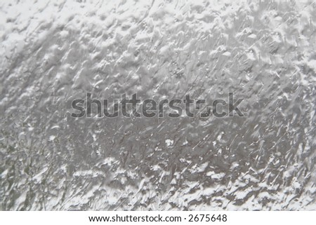 Winter storm ice coating on a window - stock photo