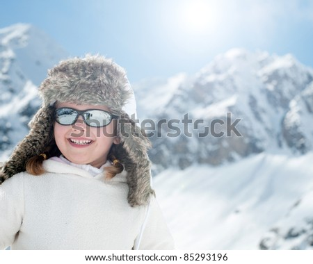 Winter, sun, snow and fun - little girl portrait - space for text - stock photo