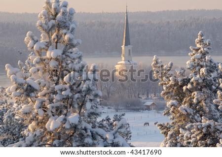 Winter sundown church - stock photo