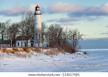 Winter Sunrise at Point Aux barques lighthouse - Port Hope, Mi  USA - stock photo