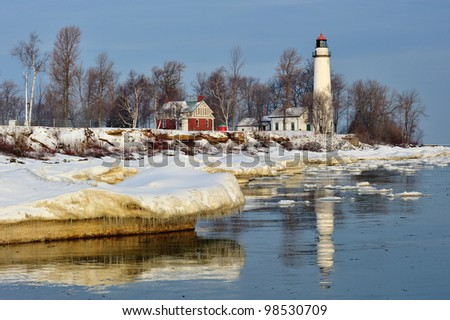 Winter sunrise at Point Aux Barques lighthouse, Port Hope Michigan, USA - stock photo
