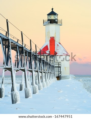 Winter sunrise at St Joseph Michigan Lighthouse - stock photo