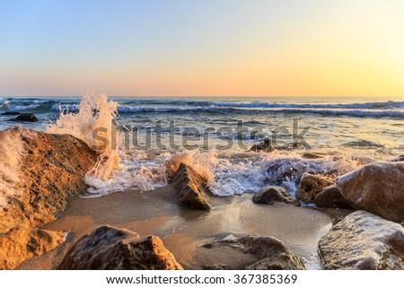 Winter sunrise on the beach - stock photo