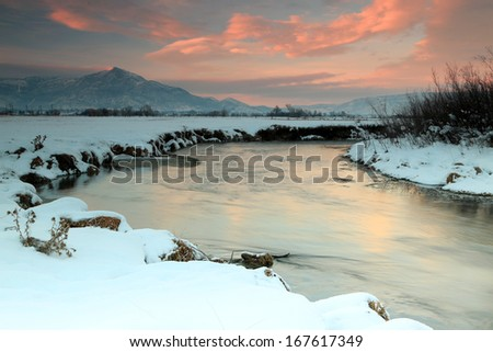 Winter sunset along the Provo River, Utah, USA.