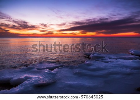 Winter sunset and ocean.