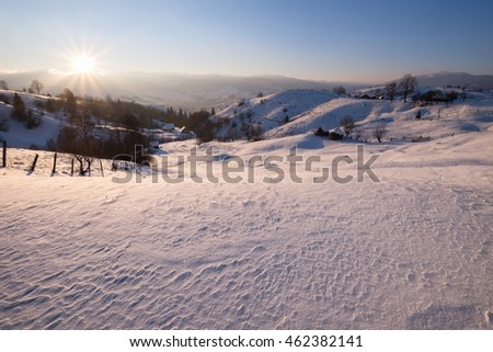 Winter sunset at mountain hills