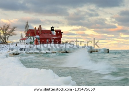 Winter sunset at Point Betsie lighthouse, Crystalia Michigan,USA - stock photo