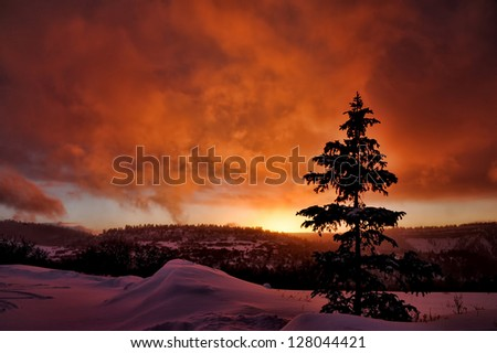 Winter sunset behind a snow covered mesa near Telluride, Colorado. - stock photo