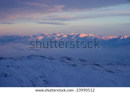 Winter sunset in mountains - stock photo