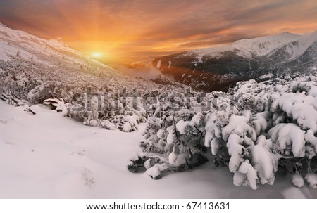 winter sunset in the Carpathian mountains - stock photo